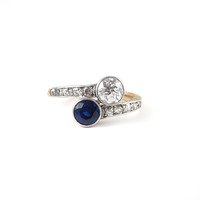 Love's Embrace in a Diamond Sapphire Bypass Ring